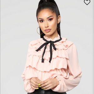 Pretty pink ruffle blouse from Fashion Nova.